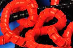 Red PTFE Spiral Wrap (PolyTetraFluoroEthylene) for Cable Storage in Harsh Environments